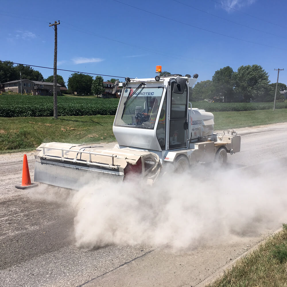 Existing pavement is swept.