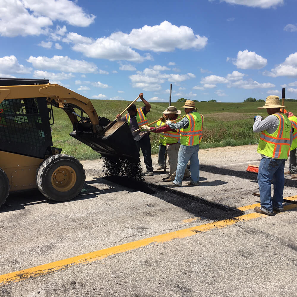 New Hot Mix Asphalt material is prepped by MWC workers.