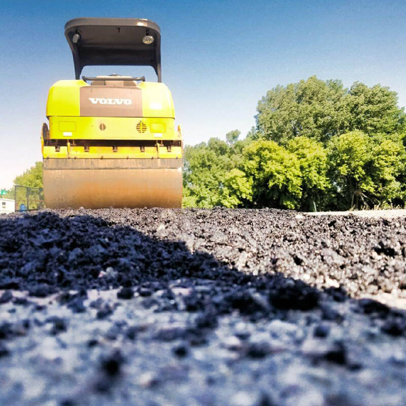 A close up of an asphalt roller.